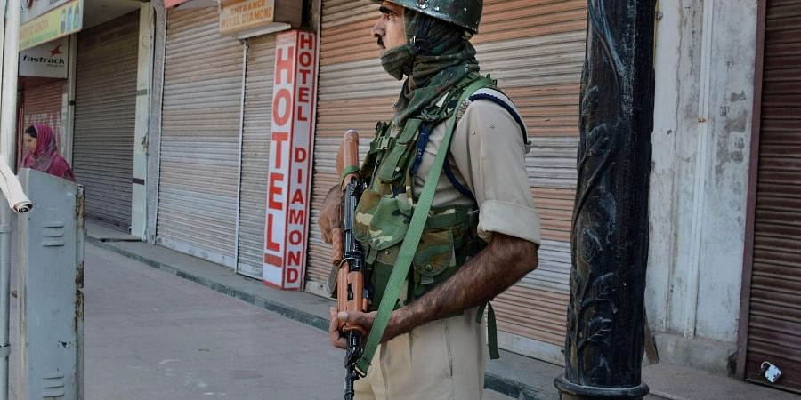A security person guards in a street on the 30th day of the restriction following abrogration of the provisions of Article of 370 in Srinagar Tuesday September 3 2019. | PTI