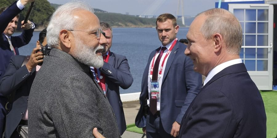Russian President Vladimir Putin, right, and Indian Prime Minister Narendra Modi shake hands during their meeting ahead of the Eastern Economic Forum at the Russky Island.