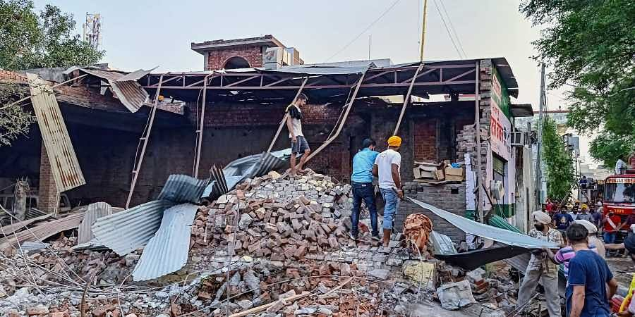 Locals carry out rescue works after a blast took place at a fireworks factory at Batala in Gurdaspur district of Punjab Wednesday September 4 2019. | PTI