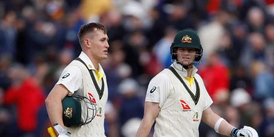 Australia's Steve Smith (R) and Marnus Labuschagne return to the pavilion for lunch break during day one of the fourth Ashes Test. (Photo | AP)
