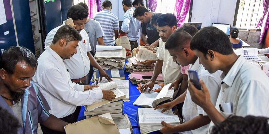 Applicants submit their appeals after the release of final NRC list at an election office, in Tezpur