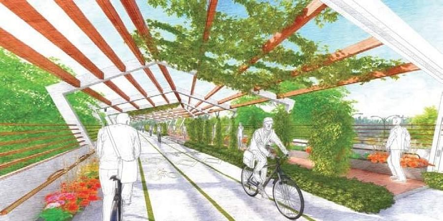An artist's impression of an elevated cycle and pedestrian corridor being planned by the land owning agency in the national capital to ensure safe commuting.