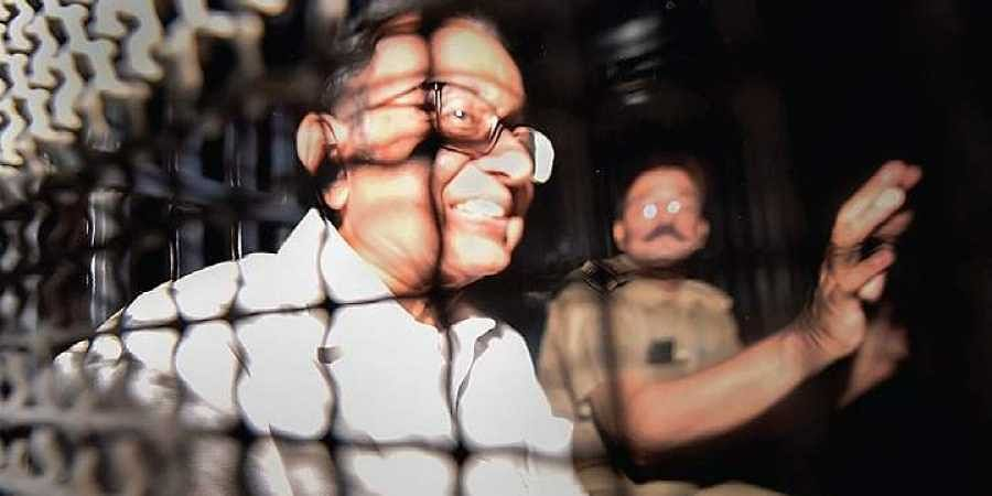Chidambaram being taken to Tihar jail in New Delhi on Thursday in a police van