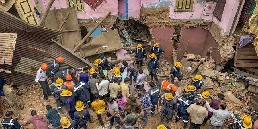 Ahmedabad Fire and Emergency Service personnel carry out rescue works after a building collapsed in Ahmedabad Thursday Sep 5 2019.