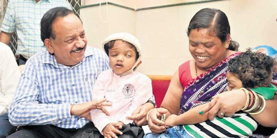 Union health minister Harsh Vardhan with Jagga, Balia and their kin after the twins, who were joined at the head, were discharged from AIIMS on Friday following surgery to separate them.
