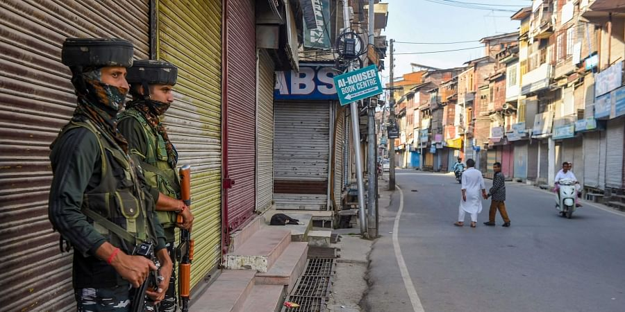 Security personnel stand guard during shutdown in Srinagar Saturday September 7 2019. | PTI