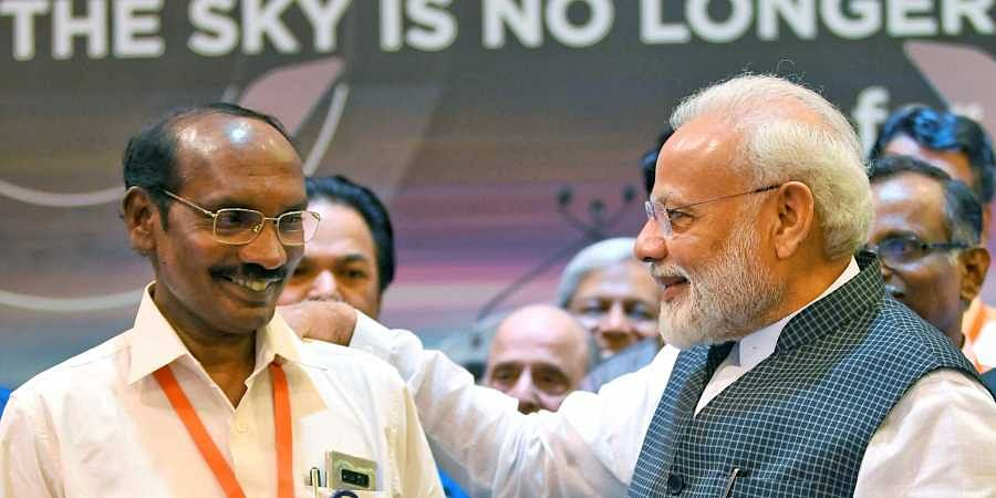 PM Narendra Modi interacts with ISRO Chairman K Sivan after connection with the Vikram lander was lost during soft landing of Chandrayaan 2 on lunar surface.