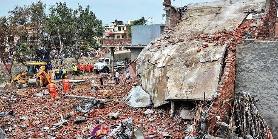 NDRF personnel carry out rescue works at the site of the blast at Batala.