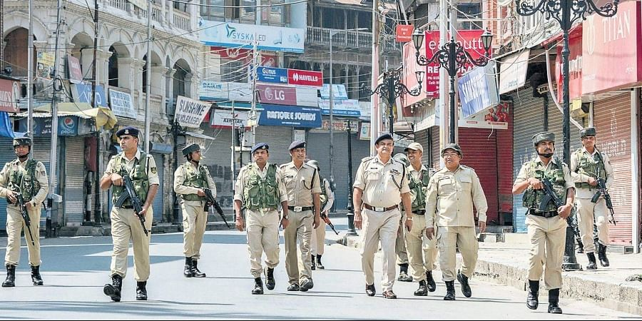 Security personnel patrol a deserted street on the 33rd day of strike and restrictions in Srinagar on Friday.