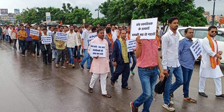 The RSS activists from various districts of the state attended the march, some carried banners and placards protesting against the violence. | Express Photo Services