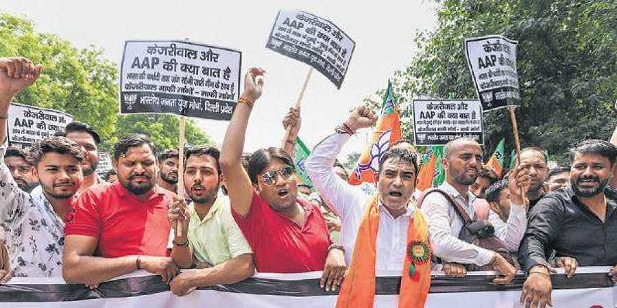 BJP Yuva Morcha activists demonstrate outside the chief minister's residence, seeking his sanction for prosecution in the JNU sedition case.