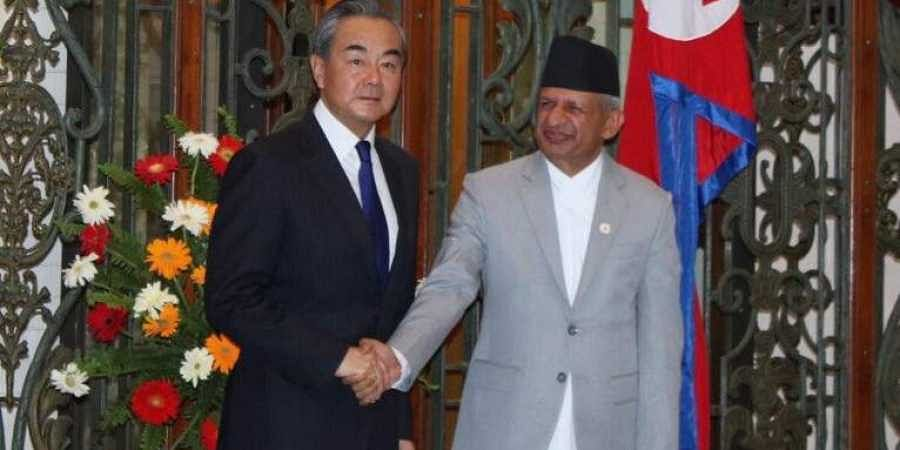 Chinese Foreign Minister Wang Yi (L) with his Nepalese counterpart Pradeep Kumar Gyawali