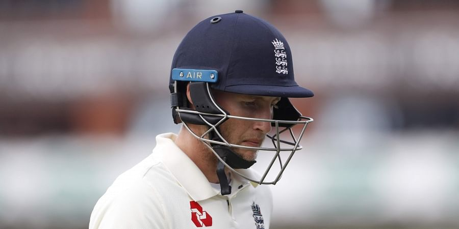 England captain Joe Root leaves the field after being dismissed during day three of the fourth Ashes Test cricket match between England and Australia at Old Trafford in Manchester, England, Friday, Sept. 6, 2019.   AP