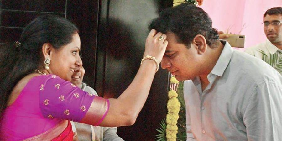 KTR being welcomed with tilak by his sister Kavitha at his house after being sworn in as Cabinet minister.