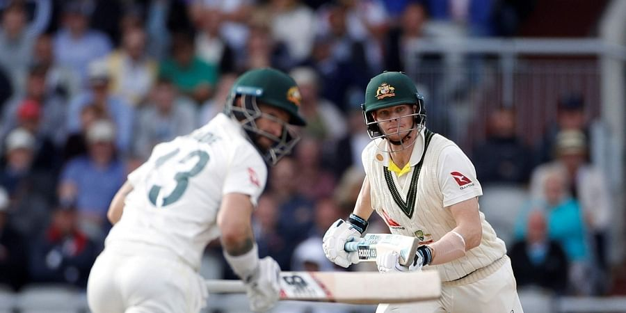 Australia's Steve Smith, right, and Matthew Wade run between wickets during day four of the fourth Ashes Test cricket match between England and Australia at Old Trafford in Manchester, England, Saturday, Sept. 7, 2019. | AP