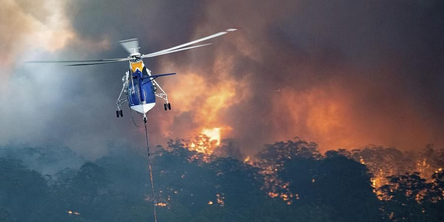 A helicopter tackles a wildfire in East Gippsland, Victoria state, Australia.
