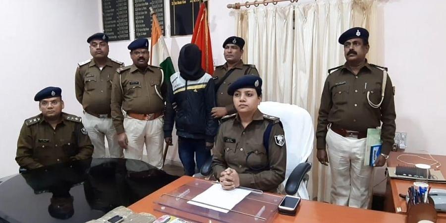 West Champaran SP Natasha Guria with the seized charas and smuggler