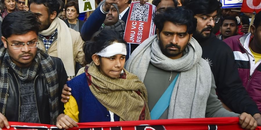JNU Students Union President Aishe Ghosh and other students during a protest march from Mandi House to HRD Ministry, demanding removal of V-C. (Photo | PTI)