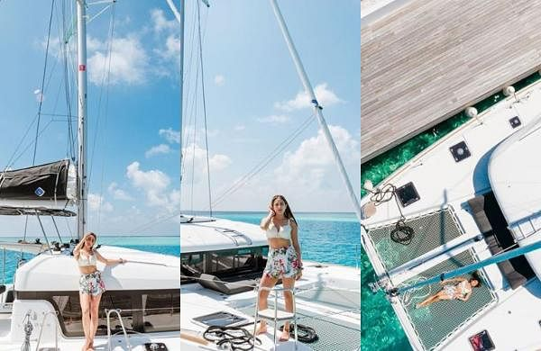 The Simmba actor is seen in a floral white mini skirt with a white top on the deck of the yacht.