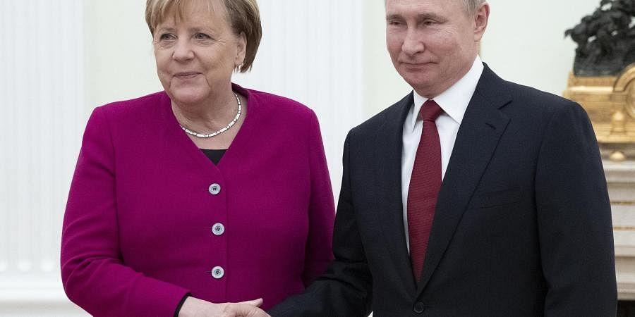 Angela Merkel Vladimir Putin Discuss Middle East Flashpoints At Kremlin Meeting The New Indian Express
