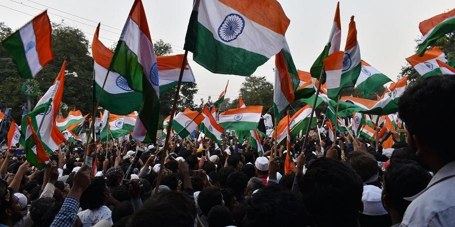 Waiving the Tricolour, shouting slogans and holding posters and banners against the Citizenship Amendment Act (CAA), thousands of people hit the streets of Hyderabad on Saturday bringing the city to a grinding halt