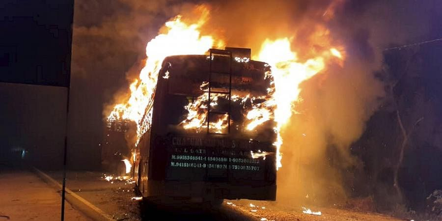 A bus catches fire after collision with a truck on GT Road at Kannauj district in Uttar Pradesh