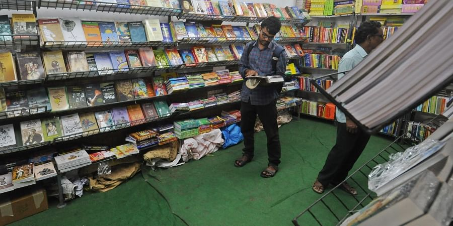 Less crowd is seen in Telugu book stalls as compared to English book stalls at the Vijayawada book festival on Friday