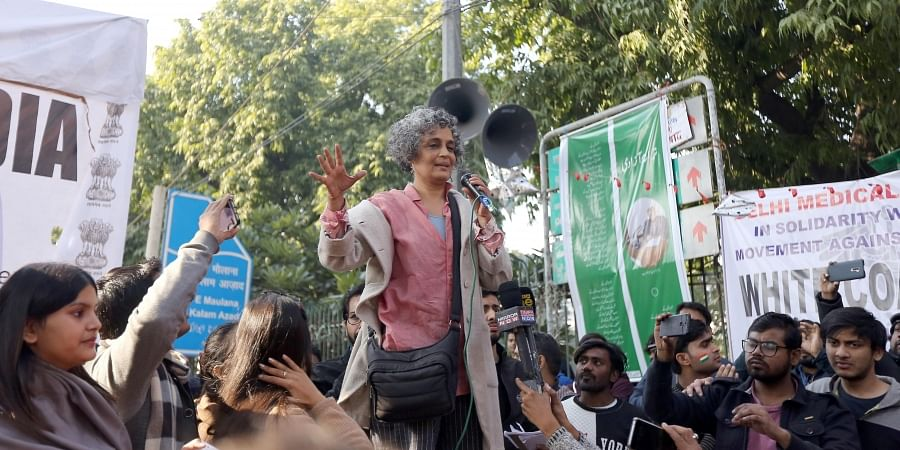 Author Arundhati Roy addresses a gathering during a protest against the CAA outside the Jamia Millia Islamia University in New Delhi on Saturday Jan. 11 2020. (Photo | Arun Kumar P/EPS)