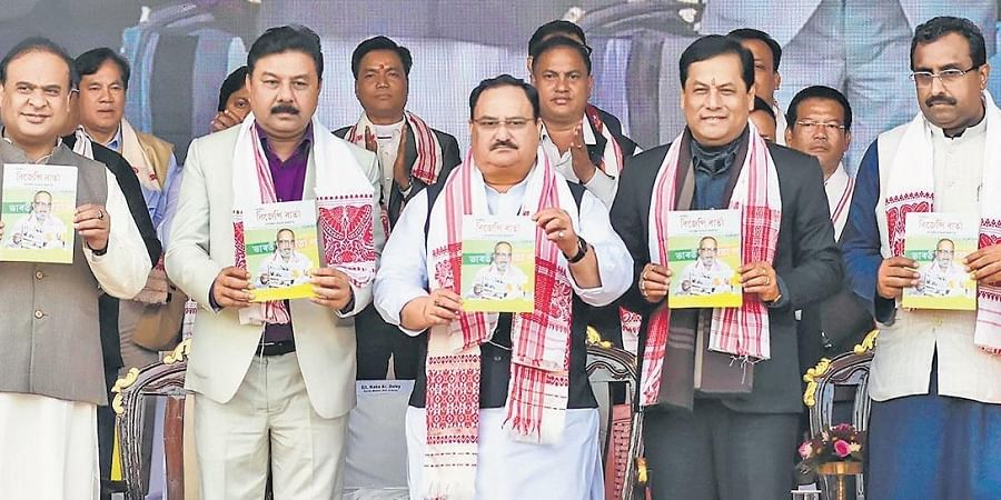 BJP working president J P Nadda, with party national general secretary Ram Madhav, Assam CM Sarbananda Sonowal, Finance Minister Himanta Biswa Sarma and others, releases the party magazine during a meet to support CAA in Guwahati.