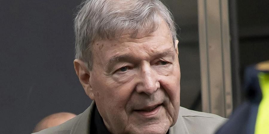 In this file photo, Cardinal George Pell arrives at the County Court in Melbourne, Australia. A newspaper reports that Pell has been transferred from a Melbourne prison after a drone illegally flew overhead in a suspected attempt to photograph the famous inmate.