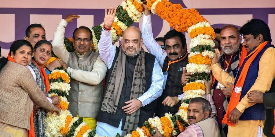 Union Home Minister Amit Shah with former MP chief minister Shivraj Singh Chouhan and State BJP president Rakesh Singh during a CAA awareness event in Jabalpur. (Photo | PTI)