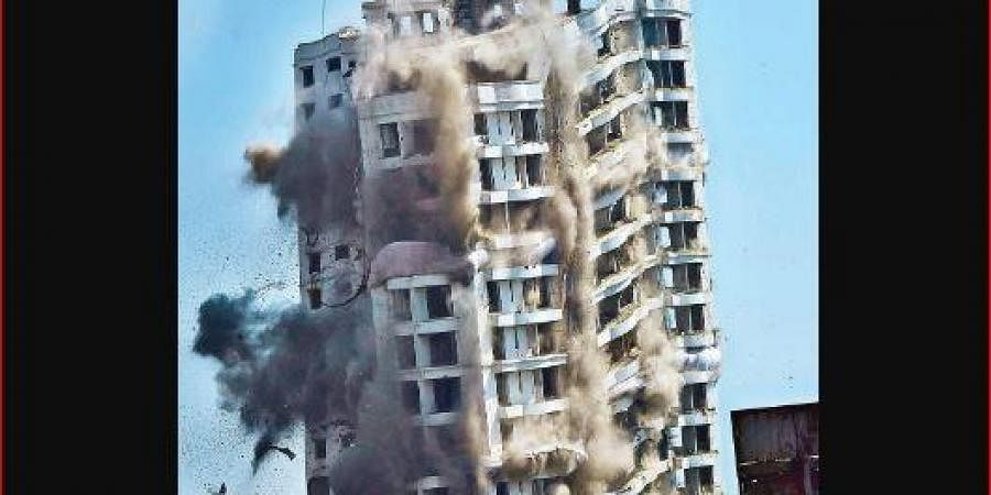 Holy Faith H2O being demolished through controlled implosion.