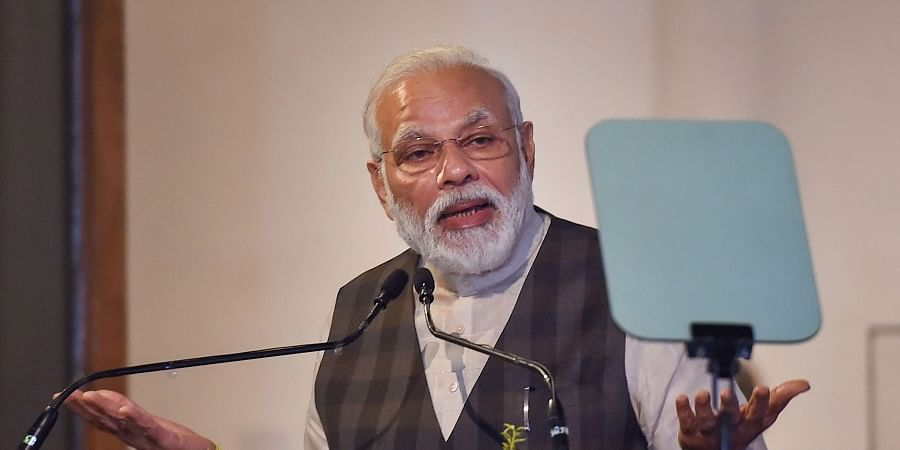 Prime Minister Narendra Modi addresses at restored 'Old Currency Building' during inauguration of 'Ghare-Baire'- an exhibition of art in Kolkata Saturday Jan. 11 2020. (Photo | PTI)