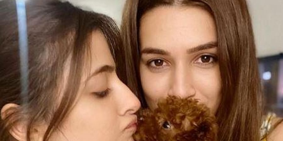 Kriti took to Instagram where she shared a photograph of herself holding the puppy along with her sister Nupur Sanon.