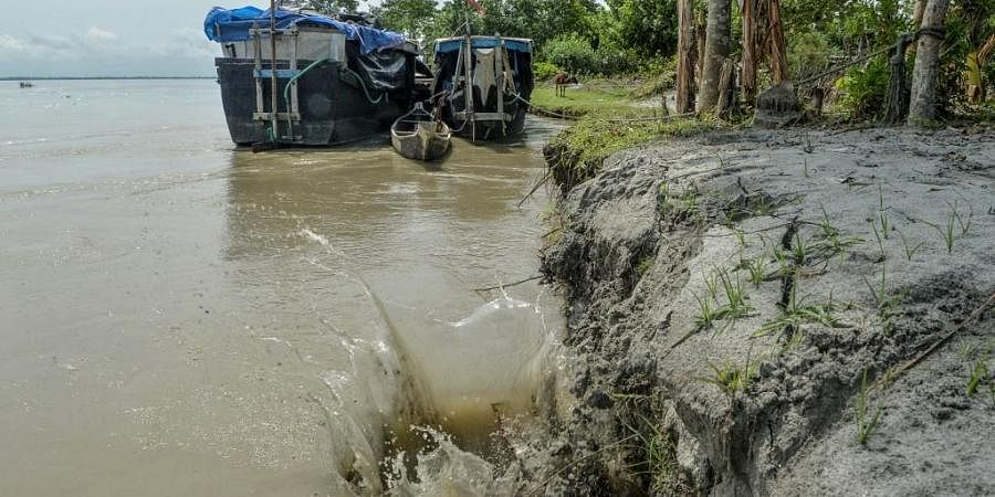 This picture taken on September 17, 2019 shows soil erosion caused by the waters of Brahmaputra river at Majuli island in Assam.