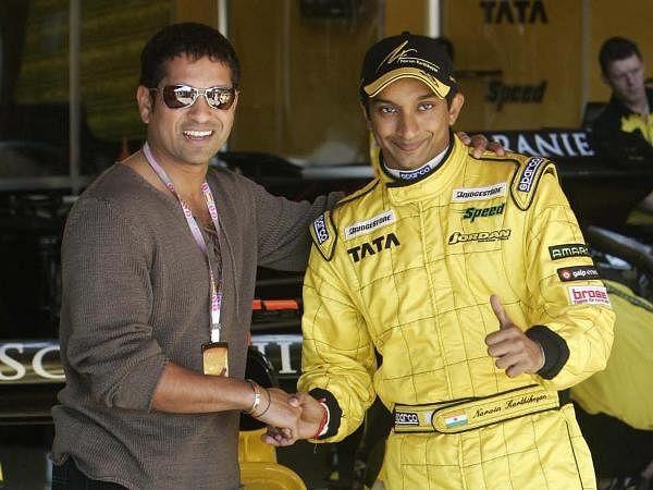 Cricket legend Sachin Tendulkar poses for a photograph with F1 racer Narain Karthikeyan at the Montello racetrack outside Barcelona Spain.