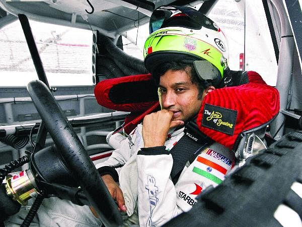 F1 racer Narain Karthikeya waits in his NASCAR Truck series truck at the Martinsville Speedway in Martinsville, Virginia.