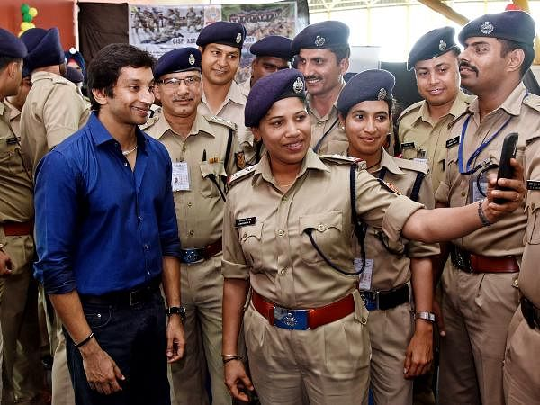 F1 racer Narain Karthikeyan, who has a motivational interaction session with CISF personnel seen posing with them at the Coimbatore airport.