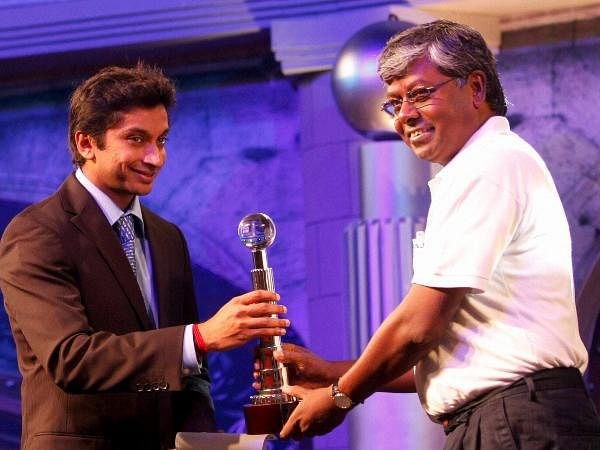 F1 racer Narain Karthikeyan presents Bike of the Year award for Bajaj Pulsar 135LS to Bajaj Two wheelers CEO S. Sridhar during the Bloomberg UTV Autocar Award in Mumbai.