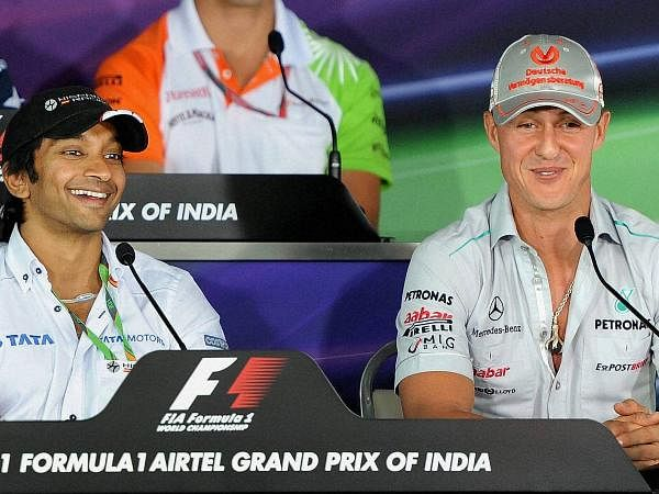 Hispania Racing Team driver Narain Karthikeyan of India and Mercedes driver Michael Schumacher of Germany addressing a press conference of the Indian Formula One Grand Prix at the Buddh International Circuit in Noida.