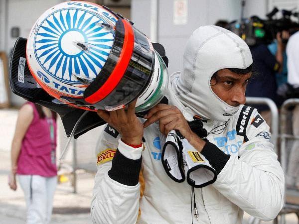Hispania Racing Team F1 racer Narain Karthikeyan of India takes his helmet off following the Qualifying session for the Malaysian Formula One Grand Prix at Sepang.