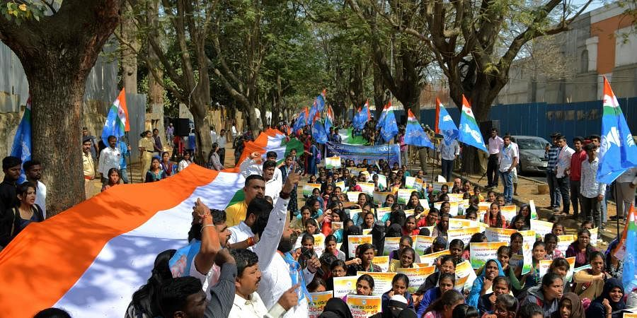 NSUI teachers and students protest against CAA on Kalidasa Road near Freedom Park in Bengaluru on Monday. (Photo | Meghana Shastry/EPS)