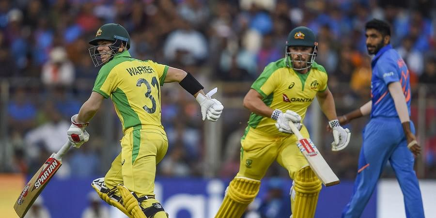 Australian batsmen Aaron Finch and David Warner run between the wickets during the first one day international ODI cricket match against India at the Wankhede Stadium in Mumbai. (Photo | PTI)