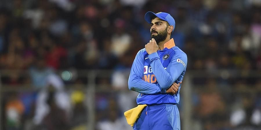 Indian captain Virat Kohli reacts during the first one day international ODI cricket match against Australia at the Wankhede Stadium in Mumbai. (Photo   PTI)