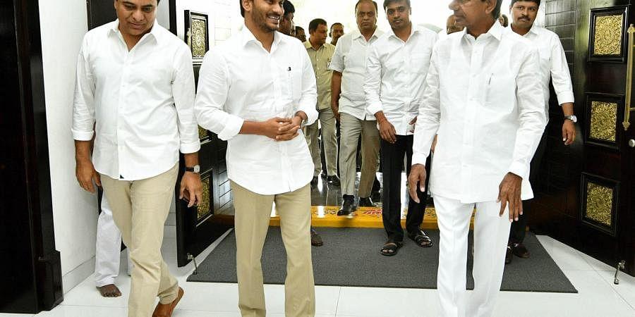Telangana CM K Chandrasekhar Rao and IT Minister KT Rama Rao welcoming Andhra Pradesh CM YS Jagan Mohan Reddy at Pragathi Bhavan in Hyderabad on Monday