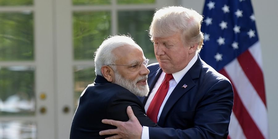 President Donald Trump and Indian Prime Minister Narendra Modi hug while making statements in the Rose Garden of the White House in Washington. (Photo   AP)