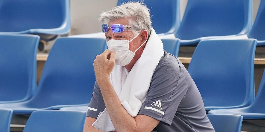 A spectator wears a mask as smoke haze shrouds Melbourne during an Australian Open practice session at Melbourne Park in Australia.