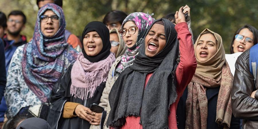 Women shout slogans during their demonstration Azad Women for Azadi against Citizenship Amendment Act and NRC at Jantar Mantar in New Delhi Tuesday Jan. 14 2020.
