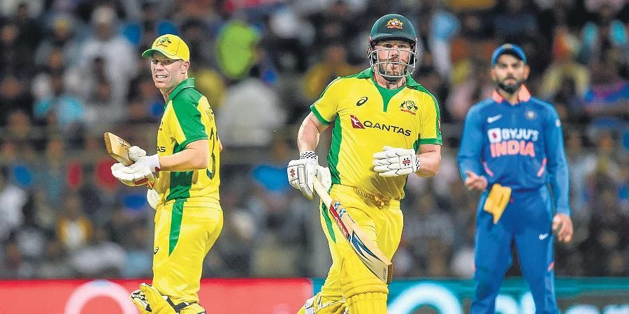 Australia openers David Warner (L) and Aaron Finch smashed unbeaten tons against India to chase down 255 in 37.4 overs, in the first ODI in Mumbai on Tuesday.