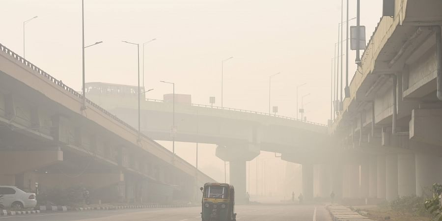 An auto plying along a road under heavy smog conditions in New Delhi on November 12 2019. | (Photo | Parveen Negi/EPS)
